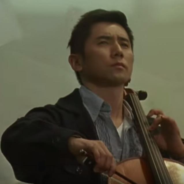 Departures movie - still image: cellist